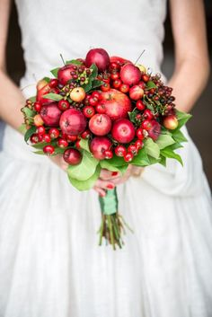 Skip the flowers and create a bright and bountiful bouquet out of winter berries and apples. Bouquet by White Agency. Fruit Wedding, Fall Wedding Bouquets, Bridesmaid Bouquet, Bridal Bouquets, Floral Bouquets, Deep Red Wedding, Autumn Wedding, Wedding White, Floral Wedding