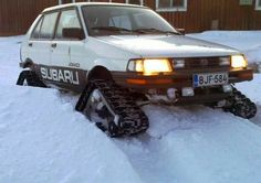 Lifted Subaru Justy with tracks