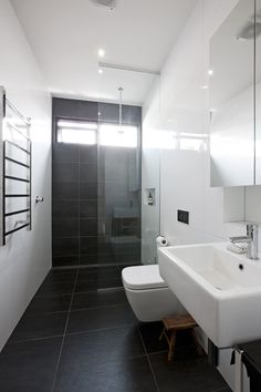 39 dark grey bathroom floor tiles ideas and pictures Grey Bathroom Floor, Black White Bathrooms, Gray And White Bathroom, Grey Bathrooms, Bathroom Flooring, Small Bathroom, Long Narrow Bathroom, Unit Bathroom, Charcoal Bathroom