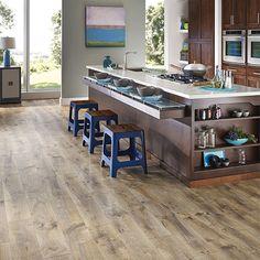 Riverbend Oak textured laminate floor. Medium oak wood finish, 10mm 1-strip plank laminate flooring, easy to install and PERGO lifetime warranty.