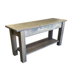 Hand crafted bench with storage shelf. The bench is constructed out of solid wood and is stained in a classic grey color. The wood has undergone an earth-friendly finishing process using multiple layers of polyurethane. The finish is durable and easy to clean. The shelf adds to functionality of the bench by adding storage. This bench is rustic but with clean lines. This would make a great bench for an entryway, mudroom, front porch or end of bed. Matching Table available in my Etsy store…