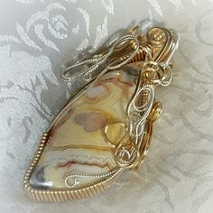 Australian Crazy Lace Gold Filled and Filigree Sterling Silver Wire Wrapped Pendant  Natural hand-cut and polished stone by Gaddabout Rock Creations @mattiegadd  #ESTHERDESTINYSJEWELRY  #AdornYourselfWithStyle  #JewelryAsHeirlooms  #PrepareForLove  #Jewelry #style #SilverJewelry #spring #springfashion #goldfilled #WireWrapped #statementnecklace #prom #wedding #statementpendant #Fashion #love #boho #bohemian  Thank you for following!