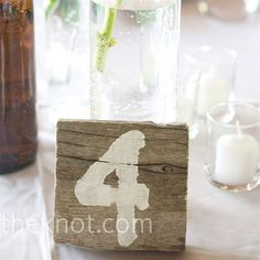 Table number painted on weathered wood