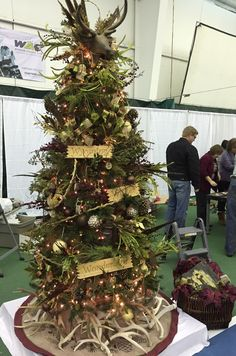 Wyoming Western Wonderland tree designed & decorated by CCA NJHS students for Festival of Trees 2015-real deer horns for base