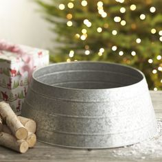 Introducing a new, modern alternative to the tree skirt, our exclusive galvanized zinc collar displays unique, rustic character while concealing the tree stand. ZincGalvanized finishClean with a dry clothMade in India.