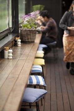 quaint stools & charcoal timber floors