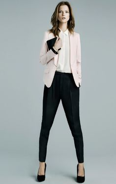 Women: Business | A blush/light pink blazer with black pants can brighten the outfit