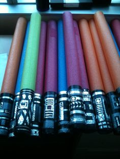 Lightsaber Pool Noodles: made from pool noodles, duct tape, and electrical tape.