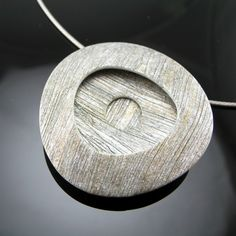 Etched dimensional polymer clay pendant by Stonehouse Studio
