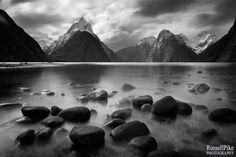Milford Sound, Fiordland National Park, Southland, New Zealand - Follow my work on my regularly updated <a href='https://www.facebook.com/pages/Russell-Pike-Photography/279443462109544'>Facebook Page</a>   Milford Sound runs 15 kilometres inland from the Tasman Sea at Dale Point - the mouth of the fiord - and is surrounded by sheer rock faces that rise 1,200 metres or more on either side. The Sound is known as the wettest inhabited place in New Zealand and one of the wettest in the world…