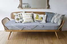 Ercol daybed with midcentury inspired cusions, Lucienne Day and Roddy & Gingerin Vriginia Armstrong Retro London Home, Annie Sloan's Room Recipes, Photography by Christopher Drake | Remodelista