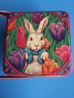 "Rabbit or Easter Bunny Tin by Department 56. Measures 4"" x 4"". Tin has handle. Top of tin has bunny pictured. 