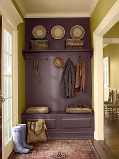 Paint a bench, wall, and shelf the same color to make it look like a built-in. Plum and green