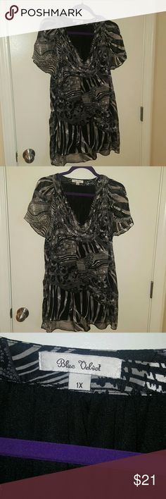Blue velvet black and white silk blouse 1x Excellent pre owned condition. She'll is silk and lining is polyester. The sleeves are sheer Blue velvet Tops Blouses