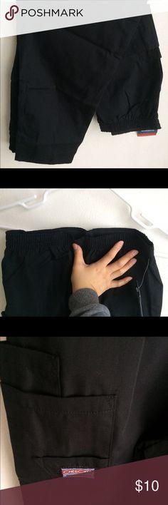 Brand new black scrub pant. Never worn black scrub pant. Cherokee brand. Side/leg pockets. Stretchy waist band. Cherokee Pants