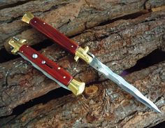 "Key West Knife Works - Outlaw Cutlery 11"" Custom Made Classic Switchblade Stiletto Cocobolo Wood Scales Kriss Blade, $84.95 (http://www.keywestknifeworks.com/outlaw-cutlery-11-custom-made-classic-switchblade-stiletto-cocobolo-wood-scales-kriss-blade/)"