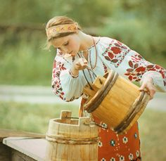 A young woman sporting eye-catchingly patterened traditional Ukrainian clothing. - tradition at heart