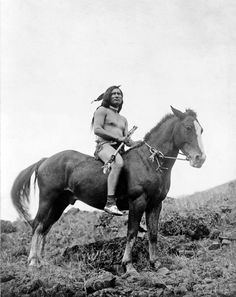 warrior riding a cross between the Appaloosa and Akhal Teke breeds, called the Nez Perce horse. Picture from 1910.