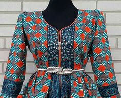 African print blouse zipper in front with rhinestone,peplum top to wear with skirt or short Blouse is ready to ship Fully linned Belt not included Zipper color might be different from the one on picture.  Available in all sizes 0 _12us Xsmall_1x standard us size  Please drop round your arm measurement when you place order for better fit .  Fabric care;  Dry clean iron at the back