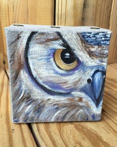 """This beautiful hand painted abstract owl is painted on 4x4"""" canvas. The artist is Lindy Tate, a local Memphian that owns Taterbuggin' by Lindy Tate."""