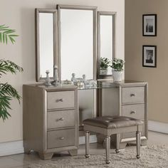 """3 pc Fontaine antique champagne finish wood bedroom makeup vanity sitting table and mirror set. This set includes the vanity table large tri fold mirror and stool.  Vanity measures 60"""" x 18"""" x 32"""" H, Mirror measures 78"""" H x 56"""" Wide.  Stool measures 21.5"""" x 17.5"""" x 18"""" H.  Some assembly required."""