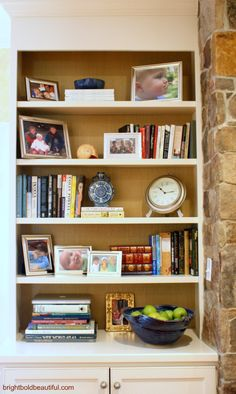 bookshelf styling ideas - wall paper (grass cloth) behind