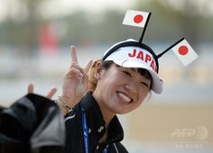 A team member of Japan's Mayumi Okunishi gestures during the equestrian dressage team competition at Dream Park during the 2014 Asian Games in Incheon on September 20, 2014. (c)AFP/Prakash SINGH ▼22Sep2014AFP|【特集】カメラがとらえたアジア大会のワンシーン http://www.afpbb.com/articles/-/3026578 #Incheon2014