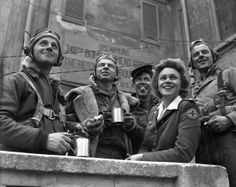 1944, Italy--Red Cross clubmobile worker with coffee and doughnuts for returning U.S. Army Air Force bombers.