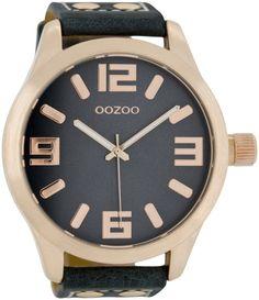 OOZOO Horloge Timepieces Collection 51 mm C1107. Stoer vormgegeven OOZOO horloge met rosekleurige kast en donkerblauwe horlogeband. Het horloge heeft een doorsnede van 51 mm, heeft een donkerblauwe wijzerplaat met rosekleurige index, wijzers en is spatwaterdicht. De  horlogeband heeft een gespsluiting. Trendy, stoer en sportief model welke zowel door dames als heren gedragen kan worden.