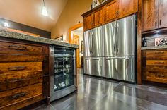 Excalibur Custom Home | Nanaimo | Ridgeview - wine fridge in island, double refrigerators in kitchen
