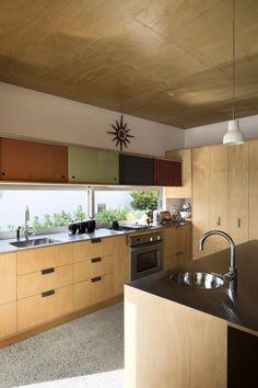 Brown Vujcich House by Bossley Architects - plywood kitchen.  Love...Windows