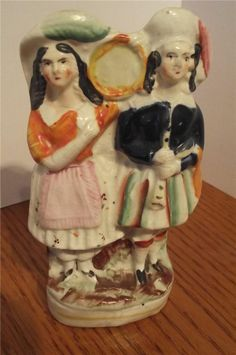 ANTIQUE STAFFORDSHIRE FIGURINE HIGHLAND COUPLE ....now we're talking.