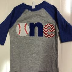 First birthday baseball shirt, ONE   If your little boy loves baseball this shirt if perfect to help celebrate him turning 1  --Baseball