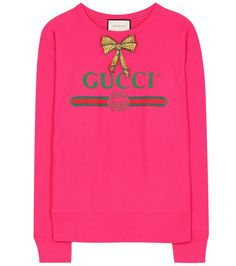 Gucci - Embellished cotton-jersey sweatshirt - Make a lasting impression with Gucci's head-turning fuchsia sweater. Crafted in Italy from from soft cotton-jersey fabric, this roomy style is printed with the brand's iconic logo and comes with a charming bead-adorned bow detail at the neckline. Team yours with track pants and sneakers for an insouciant daytime look. seen @ www.mytheresa.com