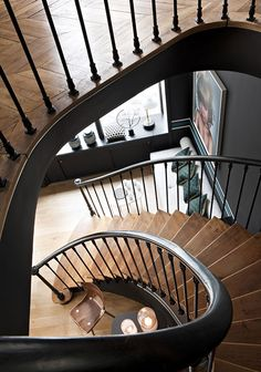 Iron spindles and beautiful treads give this custom staircase a glamorous feel. New Paris Boutique in Est Magazine. Staircase Interior Design, Foyer Staircase, Loft Stairs, Stair Steps, Stairway To Heaven, Beautiful Buildings, Stairways, Architecture Details, Home Deco