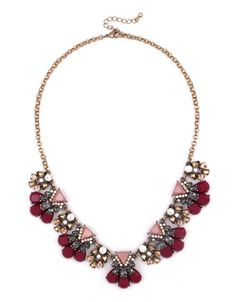 A dynamic duo, sparkling crystals and pink triangular stones pair up in this statement-making necklace, creating the perfect piece to brighten your fall look. | $48.00
