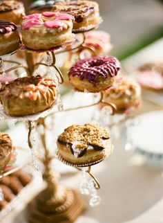 Serve donuts on an ornate candle holder.    This candle holder with crystal drops as decoration doubles as an elegant donut stand and a decorative piece.