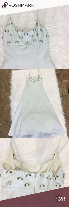 {Zum Zum} Vintage Baby Blue Formal Gown •Used, has a few small stains on the back •Baby Blue w/ white and green floral details •Tulle layering underneath  •Sleeveless •2 Layers •Vintage Style  •I would like to sell this ASAP, I'm open to any reasonable offers •Lining: 100% Acetate Dress: 100% Polyester   💕Please ask any questions you may have before purchasing, I'll try to answer every one as best I can💕 Zum Zum by Niki Livas Dresses Prom