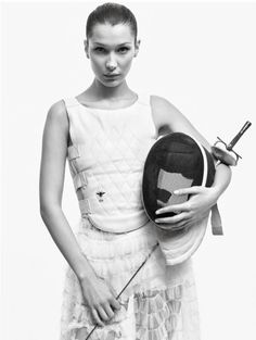 Photographed in black and white, Bella Hadid channels her inner fencer in Dior top and skirt