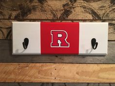 A personal favorite from my Etsy shop https://www.etsy.com/listing/469966477/rutgers-2-hook-hat-coat-rack