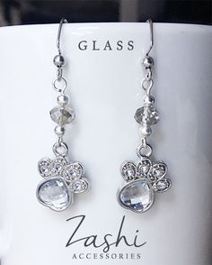 Proudly show off your love for pets with these dressy silver paw print earrings. Each earring is adorned with faceted glass and silver beads and cute sparkling paw print charms.