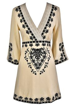 This pretty embroidered black and beige caftan dress is the perfect option to pack on vacation for a chic resort look. The Caftan Cute Black and Beige Embroidered Dress looks great worn casually with flats or dressed up for dinner with wedges or heels.  It can also be worn as a cute swimwear cover-up.  This dress has a surplice crossover neckline trimmed in lace.  Black embroidered designs decorate the bodice as well as each sleeve.  Each sleeve has a side slit and a slight bell shape…