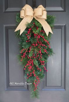 Beautiful for Christmas home and door decor. Limited quantity available. - Designed on a artificial mixed pine teardrop swag - Features a natural burlap Christmas Swags, Christmas Door Decorations, Noel Christmas, Outdoor Christmas, Holiday Wreaths, Rustic Christmas, Simple Christmas, Holiday Decor, Door Bows Christmas