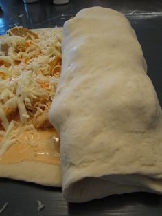 """Buffalo Chicken Garbage Bread. 2 boneless chicken breasts 1 tsp. olive oil 1 pizza dough (I used store bought and let it sit out for about 20 minutes) 8 oz. of shredded mozzarella cheese (I used part skim) 3 oz. of shredded cheddar cheese 1/2 cup of Franks Wing Sauce 1/3 cup of ranch or blue cheese dressing----"""