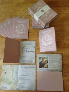 Passport wedding invitation booklets with a logo of the bride & grooms initials, pastel pink elegant theme. Designed by prettyinprint.me