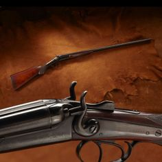 Annie Oakley's Gold Hibbard .410 Shotgun - Manufactured in Chicago, Gold Hibbard was the trade brand name used by Hibbard, Spencer & Bartlett on their general market line of imported shotguns. This shotgun was reputedly given by Annie Oakley to Mary Estell Beavers, a close friend during a shooting exhibition in Oklahoma.