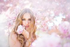 Beautiful model Laura in cherry blossom tree! Photography by www.you-photo.nl
