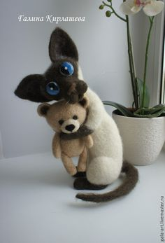 Needle felted cross eyed Siamese cat and his teddy bear. By Galina Kirlasheva.