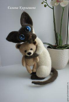 Needle felted cross eyed Siamese cat and his teddy bear. By Galina Kirlasheva.