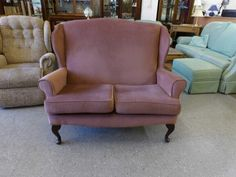 Two seater wing back sofa -------------- £125 (pc092)